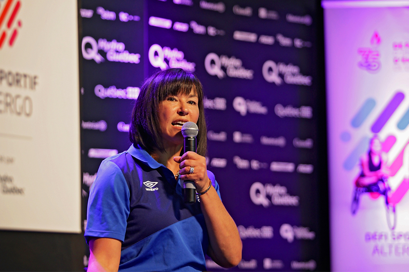 Chantal Petitclerc delivering a speech on stage.